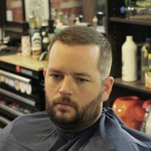 fat guy with a buzz cut